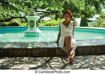 girl in a park near the fountain