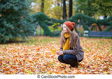 Girl in a park on a fall day