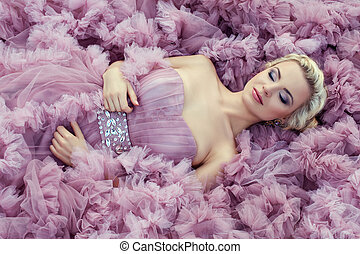 Girl in a pink dress sleeping. - Beautiful young blond girl...