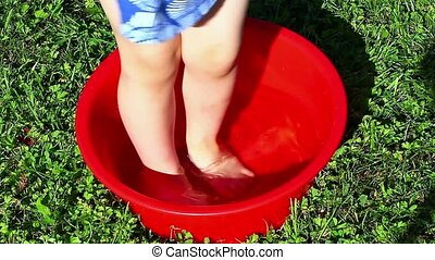 Girl in a plastic bowl of water