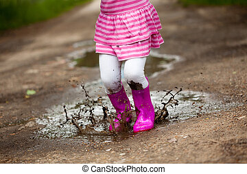 Girl in a puddle - Little girl in a puddle