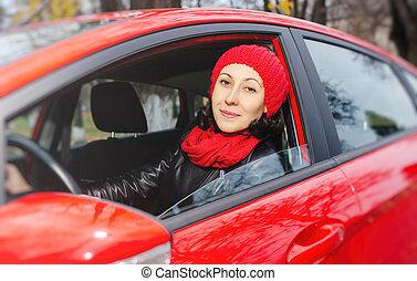 Girl in a red car in winter