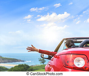 Girl in a red convertible car. - Girl in a red convertible...