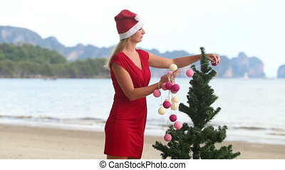 girl in a red dress and a Christmas cap