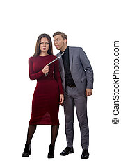 girl in a red dress pulling man by tie