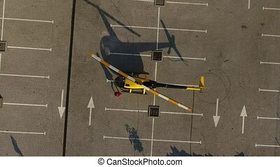 Girl in a red dress sits in a helicopter
