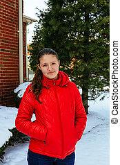 Girl in a red hat walks in Winter Park