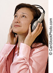 Girl in a red shirt with headphones