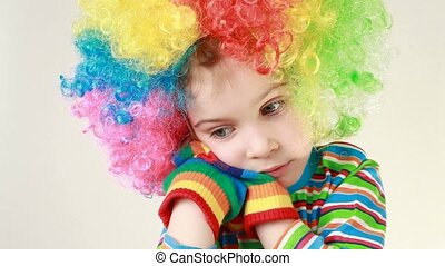 Girl in a ridiculous multicolor wig beats hands over her...