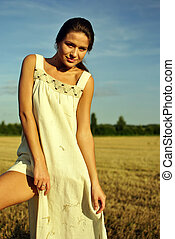 girl in a rural clothing standing on the field