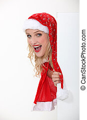 Girl in a Santa costume and board left blank for your message