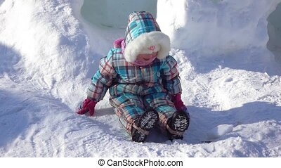 Girl in a snow hole