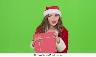 Girl in a snow maiden costume holds a gift . Green screen....