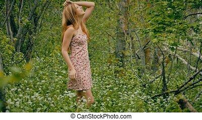 girl in a sundress in the forest in spring - blonde girl in...