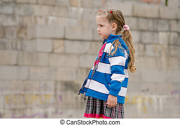 Girl in a sweater looking to the left