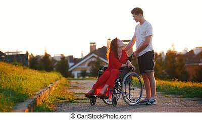 Girl In A Wheelchair Cute Talking To Her Young Man On The...