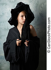 girl in a witch costume sexy looks - beautiful girl in a...
