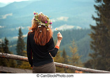 girl in a wreath of wildflowers