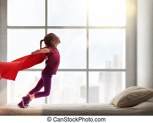 girl in an Superman's costume - Child girl in an Superman's...