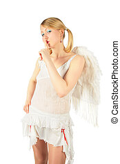 girl in angel\'s costume has put  finger to lips