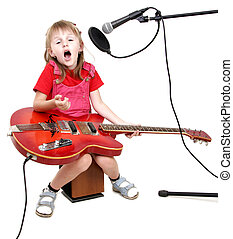 little girl sing to studio microphone and play with red electric guitar