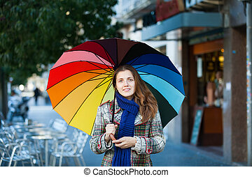 Girl in autumn jacket with umbrella