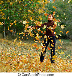 Girl in autumn leafs
