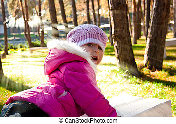 girl in autumn sunny forest