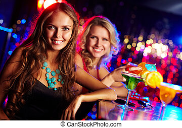 Girl in bar - Image of happy girl looking at camera with her...