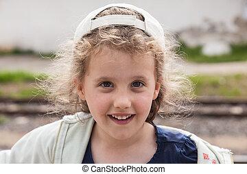 Girl in baseball hat