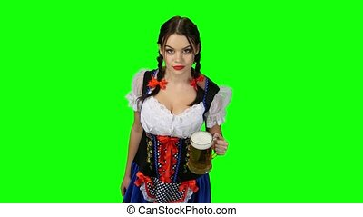 Girl in Bavarian costume celebrates Oktoberfest beer drinkers and beckons. Green screen