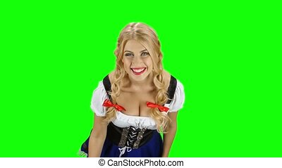 Girl in bavarian costume drinking beer and shows the thumb. Green screen