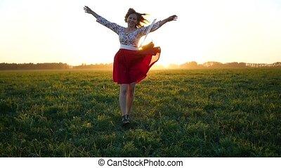 girl in beautiful dress having fun in the field