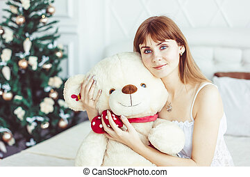 girl in bed with Teddy bear
