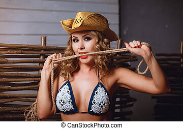 Girl in bikini and cowboy's hat