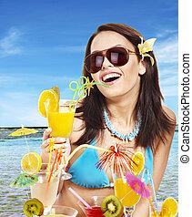Girl in bikini on beach.
