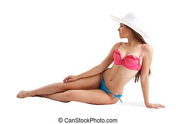 Girl in bikini sunbathing on beach. Isolated on white background