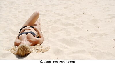 Sunbath at Sandy Beach - Girl in Black Bikini Takes Sunbath...