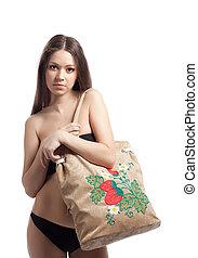 girl in black bikini with funny beach bag
