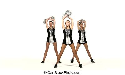 Girl in black costume with pom-poms dancing on cheerleading...