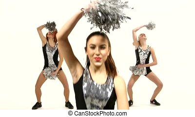 Girl in black costume  with pom-poms dancing on  white background. Close up