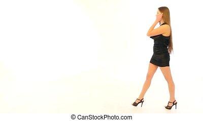 Girl in Black Dress Walking