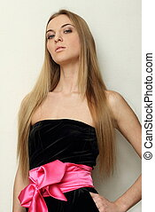 Girl in black dress with pink bow