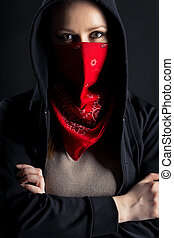 girl in black hood with a red shawl on his face