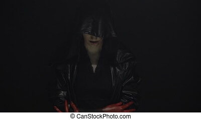 Girl in black hood with blood hands - Footage of woman...