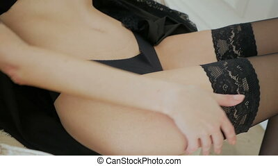 girl in black lingerie lying