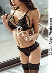 girl in black lingerie with handcuffs