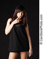 Girl in black over dark
