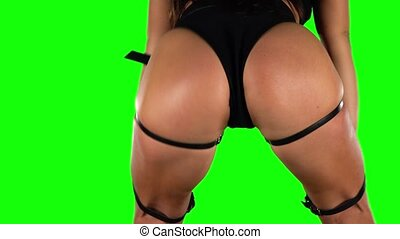 Girl in black shorts and top sexy booty dancing. Green,....