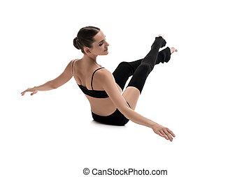 Girl in black sportswear training rearview